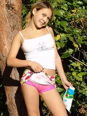 Russian teen sunbathing outside in a sexy outfit